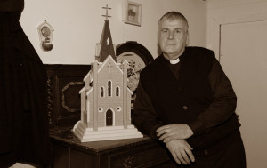 Cast member and carpenter, Michael Finnegan pictured on the set of Moll with the model of a church he made recently.