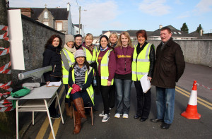 The Administrators: Members of the organising group pictured as they awaited the return of the runners, joggers and walkers at last year's Muire Gan Smál 5K Fundraiser. With the seated, Colette Mallon are: Eilis O'Leary, Annie Murphy, Tina Donovan, Noeleen O'Connor, Sheila McCarthy, Maure Browne, deputy principal; Caroline Martin and Tim Nelligan. ©Photograph: John Reidy  24-2-2013