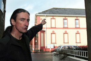 Neighbour, Redmond Roche pointing out the dangers in the wake of the storm damage to the 'Old Library' and the Kerry County Council placed bollards. ©Photograph: John Reidy