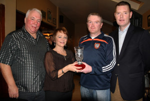 London / Kerry Person of the Year, Shelagh O'Connor pictured with her husband, Peter Middleton (left) at the presentation in her honour at Kate Pats's Bar in Brosna on Saturday night. Making the presentation is Brendan Lane, Brosna GAA Club Chairman with Kerry County Board Development Officer and Brosna native, Tim Murphy. ©Photograph: John Reidy