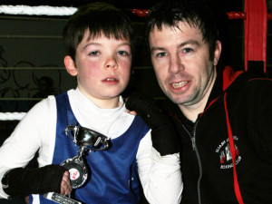 Sliabh Luachra Boxing Club members, Brandon Griffin and his dad, Paul from Kilcummin looking happy after Brandon's bout on Saturday night. ©Photograph: John Reidy