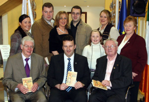 The Kingdom in the Empire author, Tommy Martin (centre front) with his father, Joe and RTÉ broadcaster Donnacha Ó Dulaing who launched the book. Included are, back from left: Catherine Toomey, Brendan Martin, Caroline Martin, Des Martin, Danielle Toomey, Charlotte and Sheila Martin.   ©Photograph: John Reidy  26-1-2007