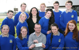 Members of the Castleisland Community College Students' Council making a donation to Jig Saw Kerry's Aidan Murphy. Included are front from left: Tara O'Shea, Máire O'Connell, Aidan Murphy, Jig Saw Kerry; Lisa Browne and Rachel O'Connor. Centre from left: Saoirse Murphy, Juanita Lovett, teacher and Caitlin Nolan. back from left: Dominic Prendiville, James McAuliffe, Sorcha O'Connor, Pádraig O'Connell and Pádraig O'Shea. Photograph: John Reidy 13-3-2014