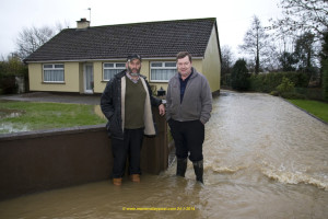 Seán Hickey (right) pictured in front of his house in Tullig, Castleisland on the Friday morning with Cllr. Danny Healy-Rae after the flood waters were diverted away from his dwelling.  ©Photograph: John Reidy  24-1-2014