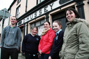 Kerry Diocesan Youth Service Castleisland based KDYS workers, Robbie Fields, Helena Falvey and Madeleine Frissung with youth club members and sisters, Ingrid and Patricia Kerins outside the former Paddy Hussey's Bar in July 2012 as it was being prepared for their move from the Island Centre. ©Photograph: John Reidy  25-7-2012