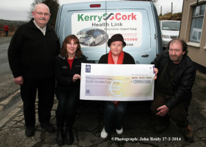 Eileen O'Connor (centre right) pictured with her husband, Thomas (left) and local volunteer, Con Reidy as they made the presentation of the proceeds of their Christmas Crib Collection to Mary Lynch, fundraising co-ordinator of the Kerry Cancer Support Group at Headley's Bridge at the weekend. ©Photograph: John Reidy