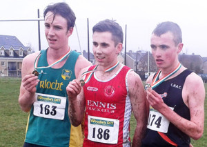 The top three finishers at the National Junior Cross Country Championships in Dundalk at the weekend included An Riocht AC athlete, Brendan O'Connor (left). Brendan finished in third place and is pictured here with winner, Kevin Mulhare, Ennis AC (centre) and Aaron O Hanlon, Clonliffe Harriers  2nd.