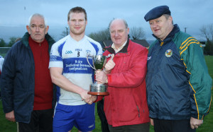 Desmonds captain, Pat Fitzgerald receiving the North Kerry League Division 1 Cup from sponsor, Con McCarthy of McCarthy Insurance Brokers, Listowel with North Kerry GAA Board officers, Mick Flavin, secretary (left) and Billy Enright, chairman after Saturday evening's final against Beale in Duagh.  Photograph: Pat Hartnett. 26-4-2014
