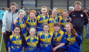 Kilmurry N.S. girls were runners up to Gael Scoil Mhic Easmainn in the Mini 7's finals held in John Mitchells, Tralee on Friday. Only a single point separated the teams in an enthralling final. The Kilmurry girls played 12 games in seven days to reach the Mini 7's final and acquitted themselves very well on the finals day. Pictured are, front from left:  Jane Lawlor, Ava Fitzmaurice, Bríd Moriarty, Laura Fitzmaurice, Kayla O' Connor. Back: Joanne Brosnan, teacher; Lisa Flynn, Aoife Kerins, Grainne O'Connor, Róisín Brosnan, Aisling Kearney and George O'Connor, coach.