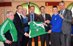 Republic of Ireland manager, Martin O'Neill joins Paul Ahern in presenting a set of jersey's to John McMahon who accepted on behalf of the youth wing of Castleisland AFC. Included are from left: Georgie O'Callaghan, Castleisland AFC youth manager;  Martin O'Neill; John Cronin, Gordon Lunn and Paul Ahern, Aherns Opel and BMW; John McMahon and John Delaney, FAI CEO. Photograph: Nora Fealey 21-3-2014