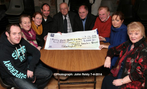 Kerry-Cork Health Link Bus representative, Seán Prendergast (centre right) receiving a cheque for €3,000 from members of the Sliabh Luachra Drama Group at the Scartaglin Heritage Centre on Monday night. Included are: Danny O'Leary, Nora Walsh, Cateriona Hickey, Vincent Salmon, John Joe Tangney, Dermot O'Leary, Moira Hughes and Mary O'Connor. ©Photograph: John Reidy 7-4-2014