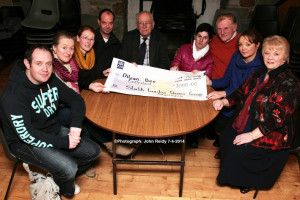 Oileán Beó / St. John of God representative, Noreen McGuire (centre right) receiving a cheque for €1,000 from members of the Sliabh Luachra Drama Group at the Scartaglin Heritage Centre on Monday night. Included are: Danny O'Leary, Nora Walsh, Cateriona Hickey, Vincent Salmon, John Joe Tangney, Dermot O'Leary, Moira Hughes and Mary O'Connor. ©Photograph: John Reidy 7-4-2014