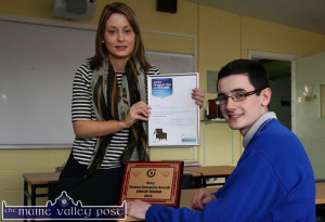 Castleisland Community College student, Christian Steinborn pictured with his teacher, Grace O'Sullivan and the rewards to date of his inventive, productive mind. ©Photograph: John Reidy 13-3-2014