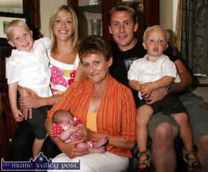Flashback to June 2007: Emergency midwife, Margaret Mitchell holding Baby Aoibhín Máidhréad with proud parents, Eamon and Noreen Ferris and their two boys, Earnán and Odhran a week after the birth at Noreen's parents' house in Castleisland where the drama unfolded. ©Photograph: John Reidy 13-6-2007