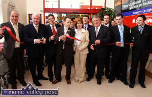 The store is open ! RTE broadcaster and TV personality, Marty Whelan (second from left) cuts through the red tape and announces the brand new Garvey's Castleisland Super-Valu open at 11am on Thursday morning. Included are: from left: Terry Dunne, MD.; Kevin McCarthy, Seamus Kerrisk, manager; Caroline McEnery, human resources manager; Jim Garvey, Tomás Garvey proprietor; Tim Brosnan, Thomas Dillane, assistant manager and Adrian Cahill. ©Photograph: John Reidy 30-6-2005