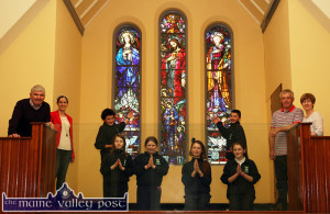 Fr. Pat Moore, PP (left) pictured with Eilish Lyons, Ellie Shanahan, Grace O'Regan, Lucy Jane O'Regan, Aydah Naughton, Seán and Joan Murphy.  Back: Edmond Healy (left) and Jake Shanahan. ©Photograph: John Reidy