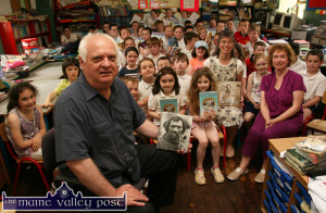 All set for the show: Author, Michael Smith pictured with teachers, Patricia Cusack and Carmel O'Connell and the new generation of Tom Crean enthusiasts at Scoil Mhuire in Knocknagoshel on Wednesday. ©Photograph: John Reidy 18-6-2014