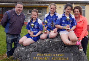 Coach, Tommy Dom O'Connor, with: Emma O'Regan, Gemma Kearney, county final overall winner 2014; Áine Sheehan and coach, Norielle O'Leary celebrating their success in the county-wide competition. Gemma was the county winner in the individual category and the Pres team came in second place in the group category.