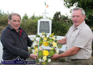 Eamonn Breen (left) and Patrick O'Leary marking the anniversary of Tom Fleming by placing a wreath on his monument at the spot in Glountane where he was killed in an explosives accident on Thursday, June 16-1921. ©Photograph: John Reidy 16-6-2014