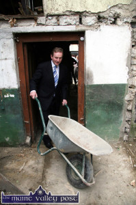 Portrait of a Cabinet maker: The now Taoiseach Edna Kenny showing that he can manouvre a wheel barrow with the best of them during a notable, pre-election visit to Castleisland in March 2007. ©Photograph: John Reidy 14-3-2007