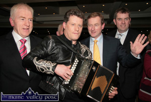 Let me tell ya all about my Five-Point Plan: FG Leader Enda Kenny arriving at the Listowel Arms Hotel to address the party faithful during the 2011 general election campaign with Kerry North / Limerick West candidates, Jimmy Deenihan, TD (left) and Cllr. John Sheahan. They are being serenaded through by musician, Liam O'Connor. ©Photograph: John Reidy 16-2-2011