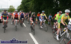 The Colours of the Rainbow flashing past as the cyclists get the nod from the starter at the 2014 St. Kieran's GAA Club Fundraising Cycle from Desmonds GAA Club grounds. ©Photograph: John Reidy 20-7-2014