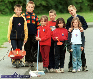 St. John's Park Tidy Towns group from 2002 getting stuck in to their task on a saturday evening in July. Included are, Emmet McCarthy (left) with: Dominic Long, Áine Riordan, RIP;  John Broderick, Amy Long, Andrew Foran and Tara Riordan. ©Photograph:  John Reidy 6-7-2002