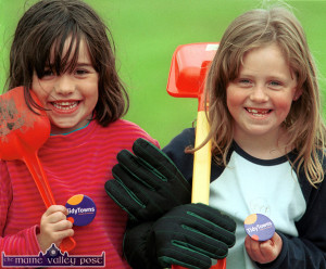 Thinking Tidy... Castleisland Tidy Towns workers, Amy Long (left) and her friend Tara Riordan pictured at work in  St. John's Park on Saturday evening.  ©Photograph: John Reidy  06/07/2002