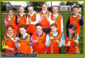 Gold Medalists: Castleisland Rounders team winners of the gold in the  Kerry Community Games Finals at Castleisland Desmonds GAA Grounds on Sunday morning. Front from left: Nicola Murphy, Maria Hanifin, Bríd Costello, Meadhbh O'Connor and Michelle Murphy. Back from left: Ciara O'Connell, Sharon McEllistrim, Áine Kennedy, Sarah Maher, Louise Joyce and Hollie Horan. ©Photograph: John Reidy  15/05/2005