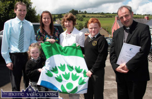 The seeds of success: The youngest and oldest pupils, Aimee Woods-Keane and Ian Walsh attending Scoil Mhuire in Brosna pictured with their fourth Green Flag at the ceremony at Brosna Community Hall in 2011 with from left: john Cahill, deputy principal; Angela Wall, Travel Education officer, An Taisce Green Schools Programme; Mary Scanlon, principal and Fr, Anthony O'Sullivan, PP Brosna. ©Photograph: John Reidy 28-6-2011