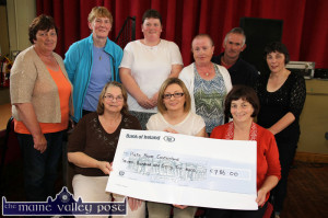 Cora O'Brien (front centre) receiving a cheque on behalf of Pieta House from the proceeds of the 2013 Carmel Linehan memorial Run / Walk committee at Knocknagoshel Community Centre. Making the presentation are: Bridget Scanlon (left) and Catherine Brosnan. back from left: Catherine Brosnan, Mary McAuliffe, Catherine Browne, Eileen O'Connor, Nelius Linehan and Marie O'Callaghan.  ©Photograph: John Reidy