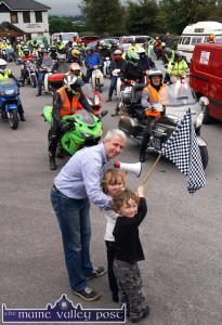 Getting the show on the Road: Seán Hanley,  Oileán Beo being helped by Moya and Daithí Daly-Lynch to get the 2013 Honda Charity Run underway in Castleisland. ©Photograph: John Reidy