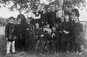 A photograph of a Cricket match at end of a scholastic retreat in Clongowes Wood College the photograph includes Castleisland native, Fr. Daniel Roche. He is on the back row fourth from right and is wearing braces. The photograph also includes the famous photographer priest Fr. Frank Browne front left and wearing Cricket pads. Front row from left:  Frs. Frank Browne, William Hackett, Michael Garahy, John Corcoran, James Brennan, Tom Murphy, William Gleeson, William McCormarck, William O' Keeffe, John Burke, William Lockington, Francis Davis, Richard Murphy (Aus) and Andy MacErlean. Back from left: : Frs. Barragry, Corbett, William Moloney (Aus), John Byrne, John O' Connor, Robert Dillon-Kelly, Michael McGrath, Joseph Flinn, Patrick Bartley, Daniel Roche, James McCann, Michael Egan and Willie Stephenson. 31-7-1905 Fr. Daniel Roche SJ M.C.(n.22 October. 1882, Castleisland, County Kerry +13 November 1961, Limerick) served with the in 1917 with the 96th (C.P.) Field Ambulance, B.E.F., France; 1918 & 1919: 18 K.L.R., B.E.F., France.