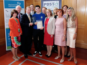 Christian Steinborn receiving the 'Sean Lemass Award for Excellence in Enterprise' from An Taoiseach, Edna Kenny TD and Minister for Education, Jan O'Sullivan, TD. Included on the left is Veronica O'Hanlon, Business teacher Castleisland Community College.