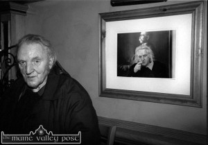 Con Houlihan ensconsed in the corner of Con's Bar in the River Island Hotel in Castleisland beside a photograph of himself on his arrival home in September 2002.  ©Photograph: John Reidy   17/09/2002