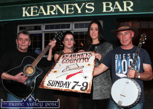 Tuning up for Kearney's Country in town from 7-9pm. Tony Halsall (left) with poster artist, Rachel Gallagher and Aoife and Proinnsias O'Sullivan before their performance at Kearney's Bar on Sunday evening. ©Photograph: John Reidy