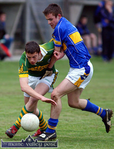 Up through the ranks: Kerry full-forward, David Moran bounces this ground ball away from Tipperary full back, John Coghlan during the 2006 ESB Munster Minor Football Championship first round game in Newcastle West.  ©Photograph:  John Reidy  26/04/2006