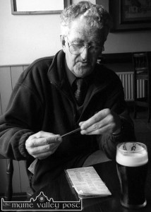 Transcription time: The Master at work in his window corner in Skevenas Bar in 2001. ©Photograph: john Reidy 18-8-2001