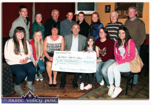 Liam Twomey, principal, St. Francis Special School, Beaufort accepting the proceeds of the third annual Paudie Fitzmaurice Tractor and Vintage Run from members of the family of the late Paudie Fitzmaurice and members of the ad-hoc committee. Included are, front from left: Laura, Ava and Mary Fitzmaurice, Liam Twomey, Sharon Fitzmaurice, Martina O'Donoghue and Gráinne Murphy. Back row: Pádraig Fitzmaurice, Nora Fealey, Charlie Farrelly, Tom Cahill, Thomas  Gillian and Harry Callaghan and Danny Kelliher. ©Photograph: John Reidy