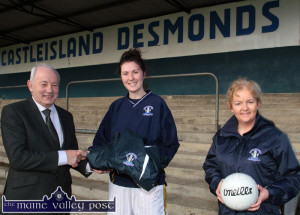 Castleisland Desmonds Ladies' GAA Club captain, Lorraine Scanlon receiving a set of track-suits from Con's Bar and Grill and River Island Hotel manager, Willie Buckley with team spokesperson, Aileen Lynch at a team training session on Sunday morning. ©Photograph: John Reidy