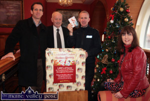 Garda Declan Kelly drawing the winning shoppers' vouchers at the River Island Hotel on Monday. Included are: Bill Costello, Castleisland Traders' Association (left) Willie Buckley, manager of the River Island Hotel and traders' association member, Grace O'Connor. ©Photograph: John Reidy