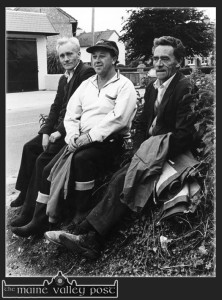 The late John Cronin (centre) pictured with his cousins John (left) and D.D. as they waited at the old entrance to St. John's Park for their drive to the bog on a July evening in 1993. ©Photograph: John Reidy 12-7-1993