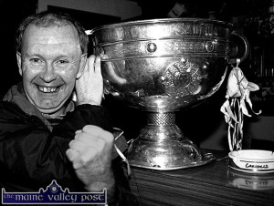 Cordal sports fan, Eddie Boyle pictured with the Sam Maguire Cup when it was brought on a visit to The Greyhound Bar in Castleisland after the 2000 All-Ireland campaign. ©Photograph: John Reidy  11-11-2000