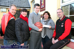 Castleisland's latest Basketball International player, Adam Donoghue receiving a presentation from St. Mary's Basketball Club PRO Bríd Kenny at St. Patrick's College on the announcement of his final selectio.  Included are Adam's mom, Eileen with Eamon Egan, St. Mary's (left) and club chairman, Maurice Casey. ©Photograph: John Reidy  6-1-2015