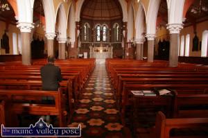 Moments of Sanctuary: A lone figure finding his own peace in the Church of Saints Stephen & John in Castleisland.  ©Photograph: John Reidy 12-2-2010