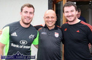 Physical Therapist, Ger Keane (centre) pictured with  Munster Rugby stars:  J.J. Hanrahan (left) and Damien Varley during their visit  to  An Riocht AC in Castleisland in August.  ©Photograph: John Reidy