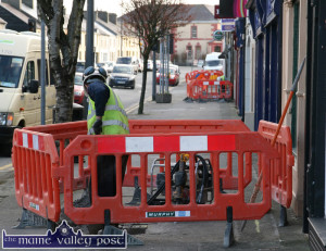 Irish Water workmen on Castleisland's Main Street in April 2014. An anti-charges public meeting will be held at the Ivy Leaf Art Centre this  Wednesday night, January 7th at 7-45pm. ©Photograph: John Reidy 1-4-2014
