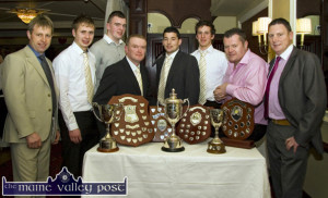More to Come: Brosna GAA Club players and officers pictured with their harvest of honours at their 2012 social at the Devon Inn in Templeglantine. Included are from left: Tim Geaney, selector; Adam Barry, minor team captain; Eamonn Prendiville, U-16 team captain; Brendan Lane, club chairman; Tom McGoldrick, senior team captain; Shane Fitzmaurice, Kerry U-17 panelist; Mike Moriarty, selector and Jimmy Keane, trainer.  ©Photograph: John Reidy