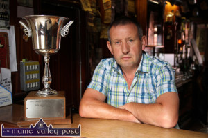 John Cronin pictured in Kate Pats' Bar with the Con Carey Memorial Cup which was donated to Brosna GAA Club by Brosna Town composer, Danny Hannon. ©Photograph: John Reidy