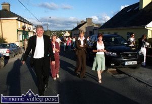 Leading his flock: Fr. Pat Moore leads his parishioners through Duagh village from the Church of the to St. Bridget's National School where a reception to mark the 25th anniversary of his ordination was held in July 2007. With him are Celia Harney and Alma Dempsey from Wexford and Mary Dowling from Lyrecrompane. ©Photograph: John Reidy 07/07/2007